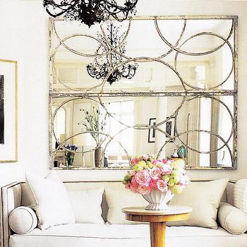 living rooms - circles mirror, high back sofa, silver circles mirror, nailhead sofa, Arteriors Iron Nikita Mirror in Silver Leaf,  Love these