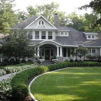 home exteriors - gray exterior, columns, wraparound porch, dormer windows,  charming house w/ a huge veranda! courtesy of Hooked on Homes' blog