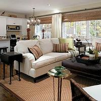Candice Olson - living rooms - green, ivory, white, sofa, brown, geometric, rug, brown, leather ottoman, nailhead trim, wicker, chair, brass, accent, table, silk, green, brown, throw, pillows, bamboo, roman shades, ivory, drapes, living room, candice olson living room, candice olson living rooms, candice olson rooms, candace olson design, candice olson interior design, candice olson,