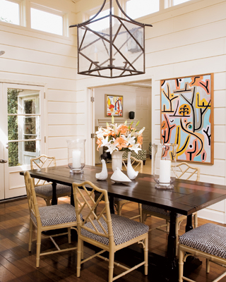 dining rooms - faux bamboo chairs black iron pendant trestl dining table white wood paneling  Large pendant lantern lighting and faux bamboo