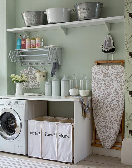 laundry/mud rooms - vintage cottage washer dryer canvas laundry bags blue gray walls  charming laundry nook from Decorology blog  green gray
