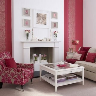 living rooms - upholstered damask chair white walls fuchsia  white living room w/ fuchsia accents from Ideal Home  fuchsia pink wallpaper, fireplace,
