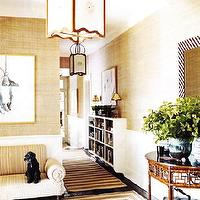 entrances/foyers - beige, ivory, gold, grasscloth, grass cloth, wallpaper, beige, white, striped, rugs, striped, French, settee, sofa, console table, chandelier, pendant, bookcase, chevron, mirror, wainscoting,