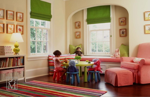 girl's rooms - green roman shades bookshelf red purple green yellow striped rug art pink glider ottoman window seat pink cushion green gourd lamp yellow walls girl's room playroom