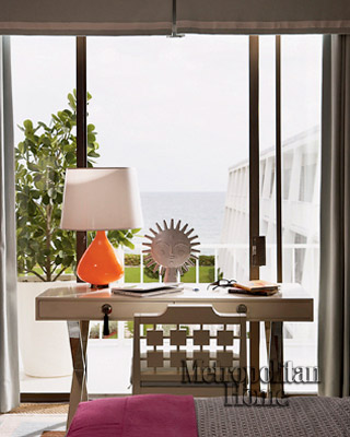 living rooms - X-base desk orange lamp sliding glass doors  Jonathan Adler's Home!   Love the desk and chair! white orange living room colors.