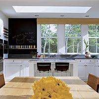 Deborah Berke & Partners - kitchens - chalkboard, paint, dining table, wicker, dining chairs, black, leather, stools, white cabinets, skylight, chalkboard wall, kitchen chalkboard wall, chalkboard, kitchen chalkboard, kitchen chalkboard ideas, chalkboard kitchen, chalkboard in kitchen, chalkboard message board, kitchen chalkboard message board,