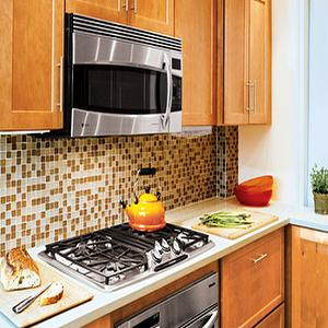kitchens - maple cabinets, maple kitchen cabinets, glass tile, glass tile backsplash, glass tile kitchen backsplash, orange and brown kitchen, above the range microwave, orange cabinets, orange kitchen cabinets,
