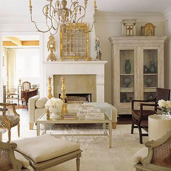 House Beautiful - living rooms - glass front armoire, living room armoire, display cabinet, gilt mirror, candle chandelier,  French country living