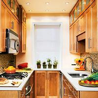 kitchens - glass tiles, cabinets, orange, brown, kitchen, galley kitchen, traditional galley kitchen, galley kitchen design, galley kitchen cabinets, maple galley cabinets, maple galley kitchen cabinets,