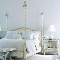 House Beautiful - bedrooms - blue, cream, poster bed, mirrored chest, nightstand, blue, gourd, lamp, blue, white, striped, bench, blue walls, bedroom, mirror nightstands, mirrored nightstands, mirrored bedside tables,