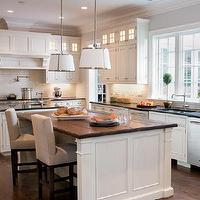 Elle Decor - kitchens - butcher block, butcher block countertops, butcher block kitchen island, butcher block island, island with wood top, island with butcher block top, two tone countertops, chase pendants, , Robert Abbey Chase Pendant,