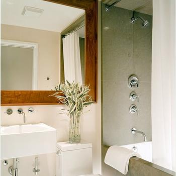 Dowling Kimm Studios - bathrooms - wall mounted sink,  Rustic wood framed bathroom mirror and modern sink! brown cream ivory bathroom colors.