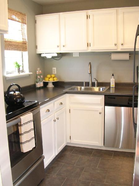 Freckles Chick - kitchens - Sherwin Williams - Sensible Hue - white painted cabinets, stainless steel, grey laminate countertops, tile floor, grey laminate, grey laminate, gray laminate countertops, grey laminate countertops,