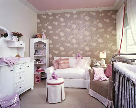 Wallpaper in girl's nursery! Crib, white sleeper sofa, brown pink glider,