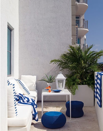 decks/patios - deck sofa table lantern blue white  Thanks to HB!  Great outdoor Mediterranean space!  Love the pops of blue! Blue white outdoor