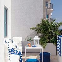 House Beautiful - decks/patios - deck, sofa, table, lantern, blue, indigo blue, indigo blue accents, high rise deck, outdoor sofa,  Great outdoor