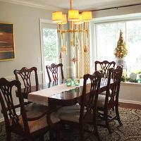 Teresa Meyer Interiors - dining rooms - chippendale chairs, chippendale dining chairs, chippendale dining room chairs, christmas chandelier, ornaments on chandelier, chandelier ornaments, chair rail, dining room chair rail, chippendale table, chippendale dining table, Bryant Chandelier,