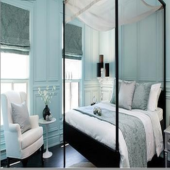 bedrooms - turquoise bedroom, turquoise blue bedroom, paneled walls, bedroom paneled walls, trim moldings, canopy bed black canopy bed, wingback chair, white wingback chair, saarinen side table, damask roman shades, blue damask roman shades, turquoise roman shades, turquoise blue roman shades, turquoise damask roman shades,