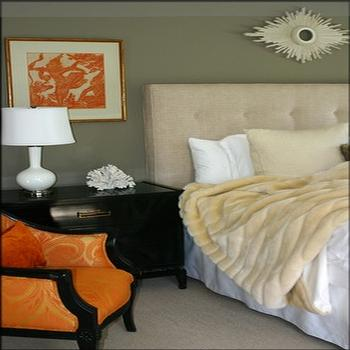 bedrooms - orange chair, orange accent chair tufted headboard, cream tufted headboard, faux fur throw,  Zoldan Interiors  orange elegant bedroom