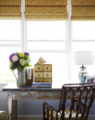 Suzie:  Beautiful!    Bamboo roman shades with painted gray wood table desk and cane chair!  ...