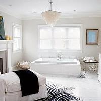 Elle Decor - bathrooms - bathroom fireplace, master bathroom fireplace, fireplace in bathroom, fireplace in master bathroom, zebra cowhide rug, chaise lounge, bathroom chaise lounge, chaise lounge in bathroom, capiz chandelier, chandelier over bathtub, , Zebra Cowhide Rug,