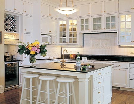 White Kitchen overlay cupboards have a beautiful granite countertop