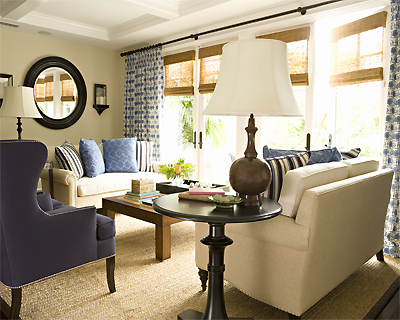 living rooms - blue, velvet, nailhead trim, wingback chair, ivory, cream, sofas, bronze, lamp, iron, floor, lamp, black, table, wood, coffee table, blue, white, drapes, bamboo, roman shades, bay windows, blue, silk, throw pillows, sisal, rug,