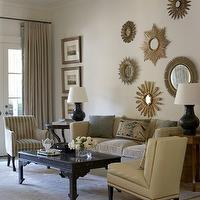 living rooms - black, coffee table, striped, beige, white, chair, nailhead trim, slipper, chair, velvet, beige, sofa, blue, beige, throw pillows, black, lamps, sunburst, bronze, mirrors, sunburst mirror, gold sunburst mirror, sunburst wall decor, collection of sunburst mirrors, sunburst wall decor,