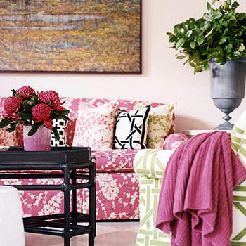 living rooms - pink sofa, patterned sofa, pink patterned sofa, patterned couch, pink patterned couch, garden lattice chair, black coffee table, tray coffee table, black tray coffee table, urn vase, pink throw, black and white pillows, garden lattice pillow,