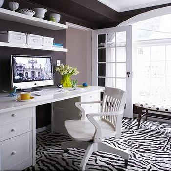 dens/libraries/offices - zebra rug, white desk, floating shelves, shelves over desk, shelves above desk, shelving over desk, shelving above desk, , Office Chair, Zebra Rug,