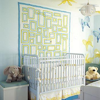 Domino Magazine - nurseries - blue and yellow nursery, jenny lind crib, white jenny lind crib, yellow and blue crib bedding,  green rug, blue