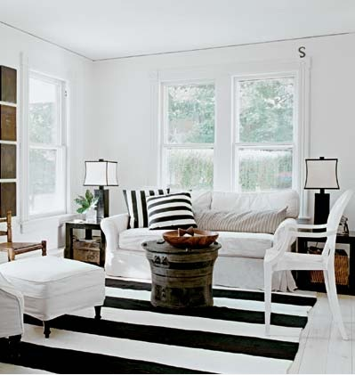 Schappacher White - living rooms - Kartell Louis Chair, striped rug, black and white striped rug, black and white living room, rolled arm sofa, slipcovered sofa, white slipcovered sofa, striped pillows, black and white striped pillows, rain drum coffee table, rain drum, black end tables, parsons end tables, black parsons end tables,