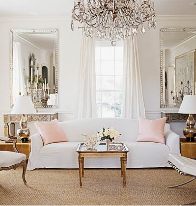living rooms - white, silk, drapes, silk, pink, pillows, white, slip-covered, sofa, French, wood, coffee table, crystal, chandelier, silver, beveled, mirrors, white, leather, tufted, Barcelona chair, silver, gourd, lamps, gray, gold, carved, wood, console, tables, brown, leather accent, end, tables, soft gray walls,