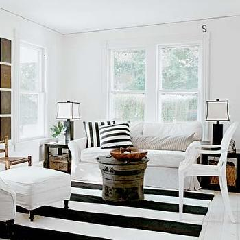 Schappacher White - living rooms - striped rug, black and white striped rug, black and white living room, rolled arm sofa, slipcovered sofa, white slipcovered sofa, striped pillows, black and white striped pillows, rain drum coffee table, rain drum, black end tables, parsons end tables, black parsons end tables, , Kartell Louis Chair,