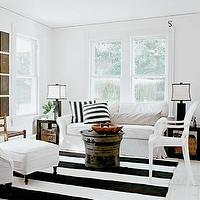 Schappacher White - living rooms - black, white, striped, rug, white, slip-covered, sofa, chair, ottoman, black, lamps, white, silk, shades, black, ribbon, border, wood, end tables, white, black, striped, pillows, , Kartell Louis Chair,