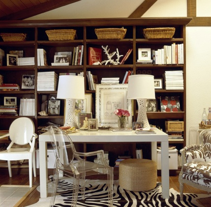 dens/libraries/offices - Ghost Chair Zebra Cowhide Rug wood bookshelf bookshelves clear white lamps white West Elm parson desk table seagrass ottoman brown white upholstered French accent chair