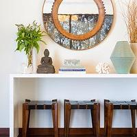 entrances/foyers - celadon, brown, stone, buddha, statue, copper, round, beveled, mirror, black, leather, wood, stools, white lacquer, modern, console, table, celadon, vase, brown, rug, wood floors,