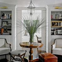 living rooms - wood, pedestal, round, table, white, accent, chairs, built-ins, cabinets, shelves, glass, pendant light, orange, red, leather ottoman, bench, stool, white, upholstered, wood, x-bench, living room,