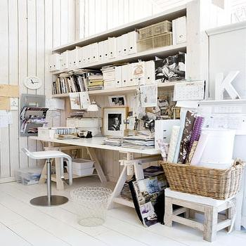 dens/libraries/offices - magazine holders, sawhorse desk, wood sawhorse desk, white sawhorse desk, white plank floor, white painted floor,  Organized