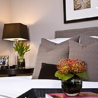 HGTV - bedrooms - beige, brown, floral, art, crystal, column, lamp, black, silk, shade, nailhead trim, nail head trim, gray, headboard, gray, linen, throw pillows, faux, black, leather, tray, gray walls, Pottery Barn, lamp, white, Pottery Barn, hotel bedding, gray, stitching, Mitchell + Gold Regis Bed,