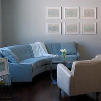 dens/libraries/offices - curved sofa, curved couch, blue curved sofa, blue tufted sofa, art made from napkins, napkins art, framed napkins,