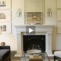 House & Home - living rooms - cream walls, cream paint, cream paint color, cream wall paint, composite fireplace, limestone composite fireplace, art flanking fireplace, gray sofa, Composite Limestone Fireplace, Imperial Trellis Fabric,