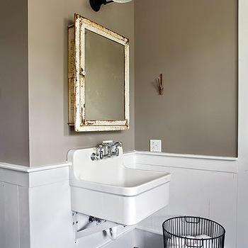 Apartment Therapy - bathrooms - taupe paint, taupe paint colors, taupe paint color, taupe walls, taupe bathrooms, distressed mirror, distressed medicine cabinet, medicine cabinet, chair rail, bathroom chair rail, wall mounted sink,