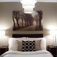 It is such a peaceful bedroom and I love the pendant and artwork.
