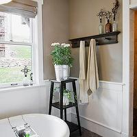 Apartment Therapy - bathrooms - tub, towel rack, wainscoting, taupe, gray, gold, white, taupe paint, taupe paint colors, taupe paint color, taupe walls, taupe bathrooms,
