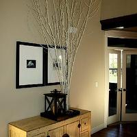 entrances/foyers - console, lantern, branches,  foyer  tall branches, asian console, gallery frames, lantern, wood floors and tall ceilings.