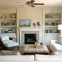 living rooms - tufted ottoman, striped ottoman, built ins, built in cabinets, living room built ins, living room built in cabinets, sectional, white sectional, ceiling fan, living room ceiling fan,