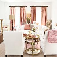 living rooms - pink drapes, pink curtains, pink window panels, pink silk drapes, pink silk curtains, pink silk window panels, pink damask throw, white and pink living room, antique brass tale, white sofa, camelback sofa, white camelback sofa, pink armoire, glass front armoire,