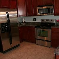 kitchens - stainless steel appliances, cherry maple cabinets, vinyl floor,  cherry maple kitchen
