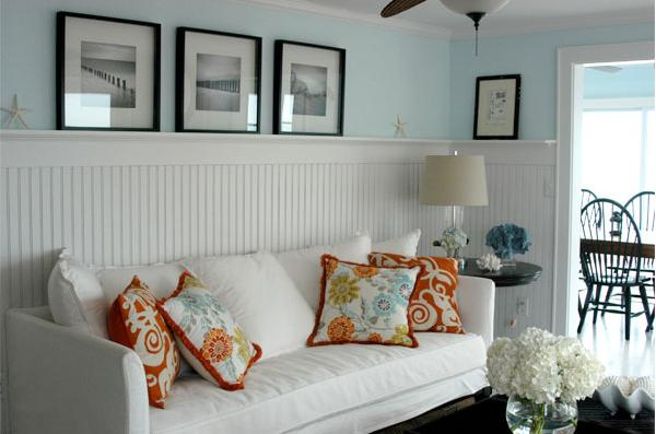 living rooms - photo gallery picture ledge white sofa orange blue green floral pillows tall beadboard glass lamp round accent wood table blue walls
